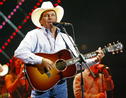 George Strait with his signature Taylor Acoustic Guitar